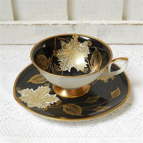 Cup And Saucer Shabby vintage tea cup and saucer german porcelain tea cups