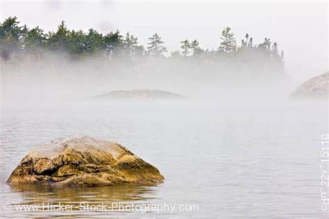 canoes in a fog lake superior sinclair cove fog lake superior lake superior provincial