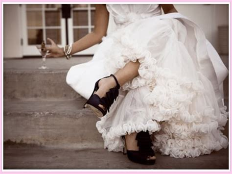ivory wedding dress with purple shoes images