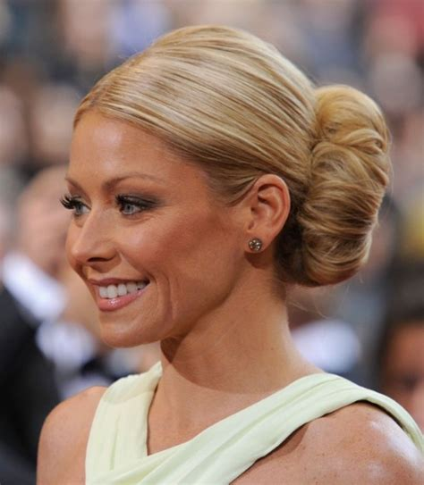 Hairstyles For Women In Their 40s Buns | kelly ripa voluminous bun hairstyle for women over 40