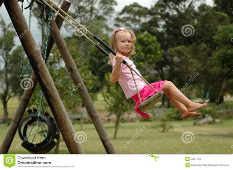 swinging with child swinging stock image image of caucasian girl