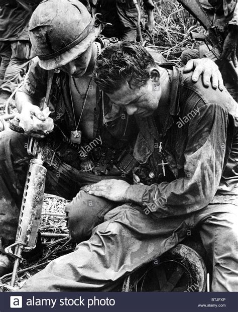 comfort each other two soldiers comfort each other under the strain of combat