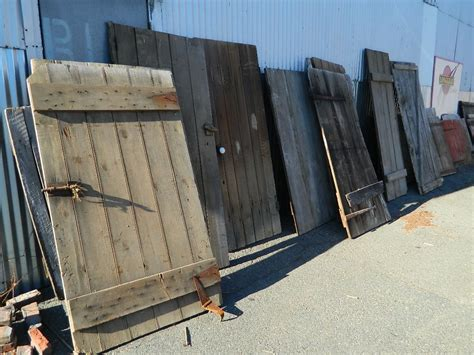 Used Barn Doors For Sale Reclaimed Barn Doors For Sale At Longleaf S Cambridge Warehouse They Stock Hewn Beams