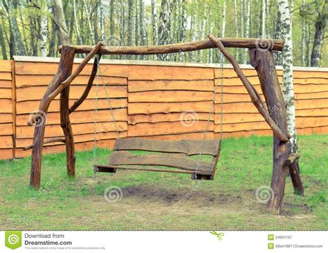 old wooden swing old wood swing in the garden royalty free stock