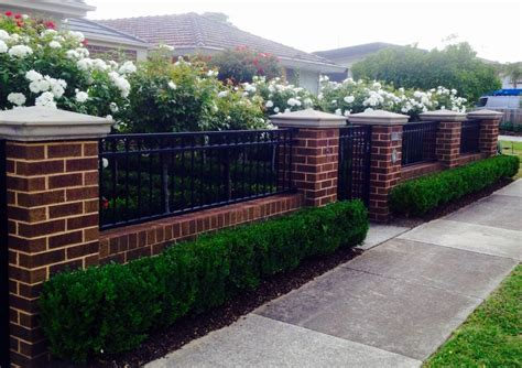 brick fence  pillars  box hedge boarder