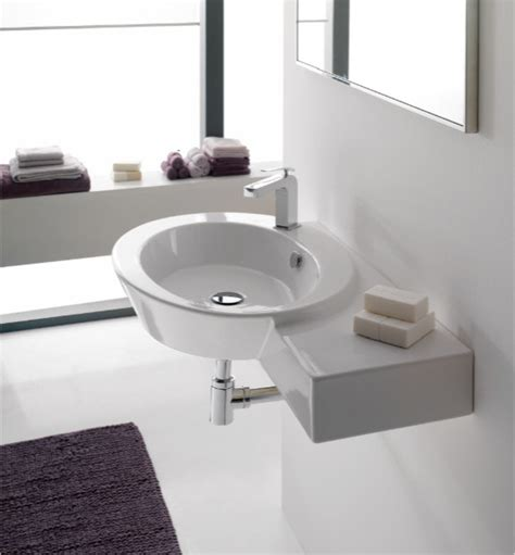 stylish oval shaped wall mounted or vessel sink with counter space contemporary bathroom