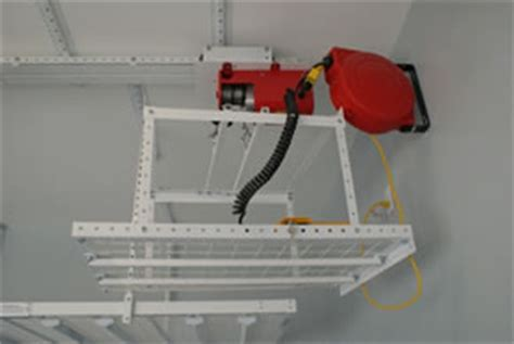 Motorized Overhead Garage Storage Systems by Overhead Racks As Garage Storage Solutions