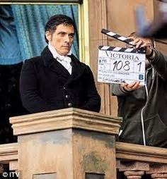 rufus sewell in costume as lord melbourne arriving at the