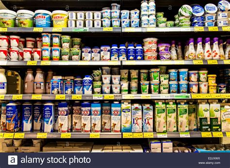 Shelf Of Refrigerated Foods by Shelf With Food In A Supermarket Refrigerated Milk Products Stock Photo Royalty Free Image