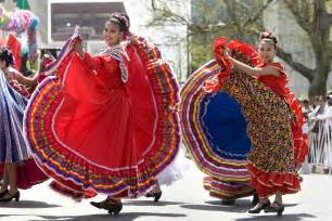 Traditional mexican dancers display colorful dresses during cinco de