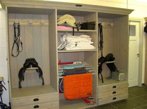 tack room ideas repurposed entertainment center that could make great mud room storage repurposed furniture