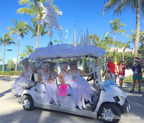 golf carts decerated for christnas the shellelf judge in the 2014 captiva golf cart parade i shelling