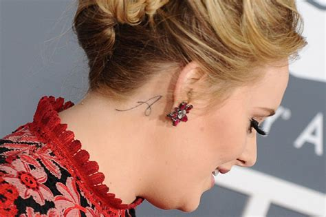 does adele s new neck tattoo mean her baby s called angelo