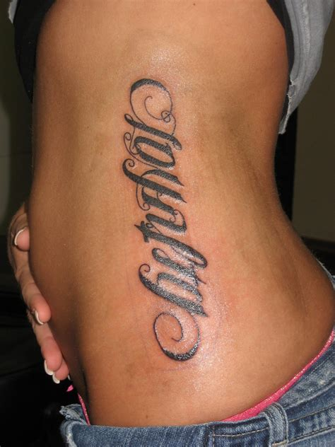 tattoos on side of ribs loyalty ambigram on rib side