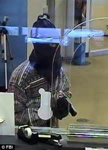 robber wanted for killing cop in bank heist dead