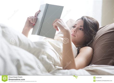 reading in bed stock image image 35335481