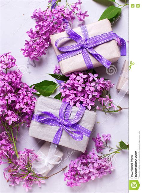 Wrapped Gift Boxes With Presents And Lilac Flowers On Grey ... Vintage Christmas Wrapping Paper