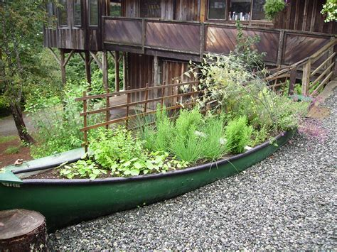 old boat flower bed diy garden art repurpose old canoes into one of a kind