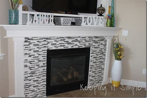 keeping it simple fireplace makeover with mosaic tiles