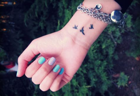 three small birds tattoo small bird tattoos with quotes quotesgram