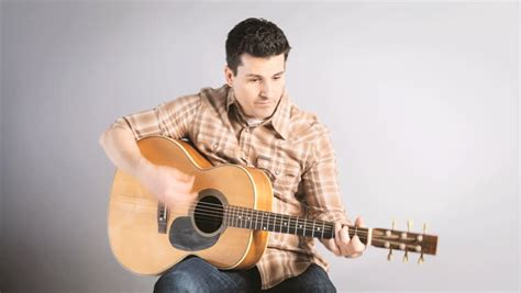 who is the man with guitar in the direct tv commercial young man playing acoustic guitar includes high quality