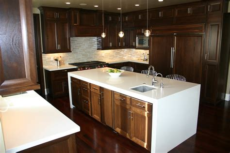 walnut kitchen cabinets granite countertops the granite gurus walnut cabinets with stone countertops
