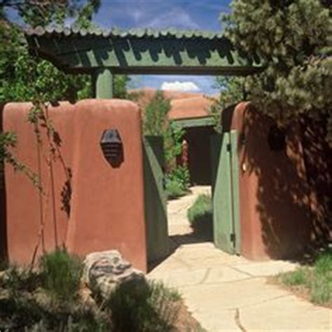 adobe home in new mexico southwestern exterior southwestern style patio with rough wood columns vitas