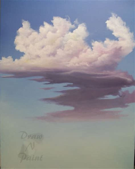artist painting clouds with color