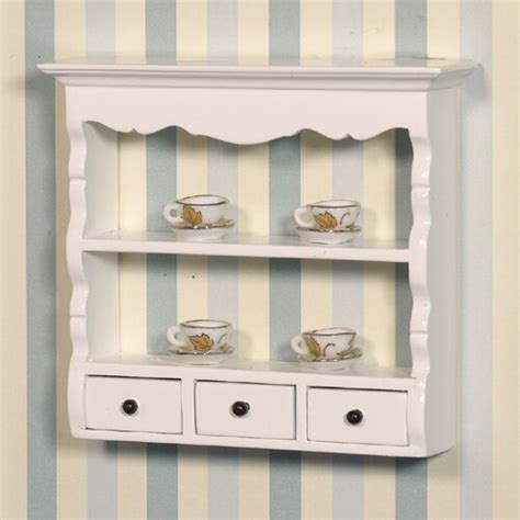 white wall shelf and drawers