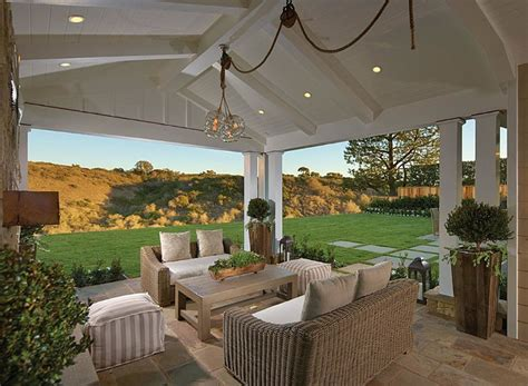 Covered Patio Lighting Ideas Coastal Home With Neutral Interiors Home Bunch Interior Design Ideas