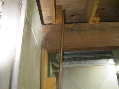 basement beam support at foundation wall internachi