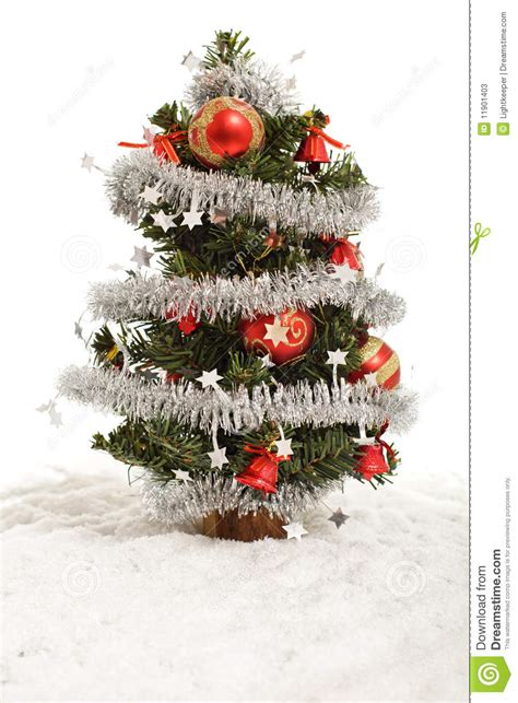 small decorative christmas tree in artificial snow stock