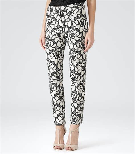 Black Patterned Trousers | pisa black white floral patterned trousers reiss
