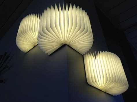 lumio a portable light that folds like a book colossal