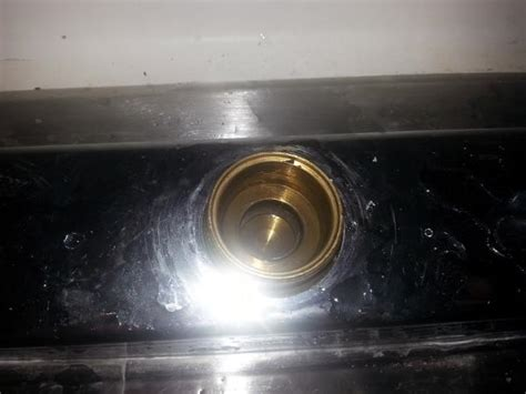 kitchen sink leaking around edges kitchen sink underneath base of spout into cabinet below