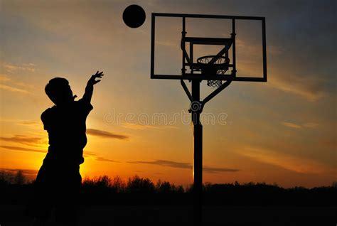 silhouette  teen boy shooting  basketball royalty