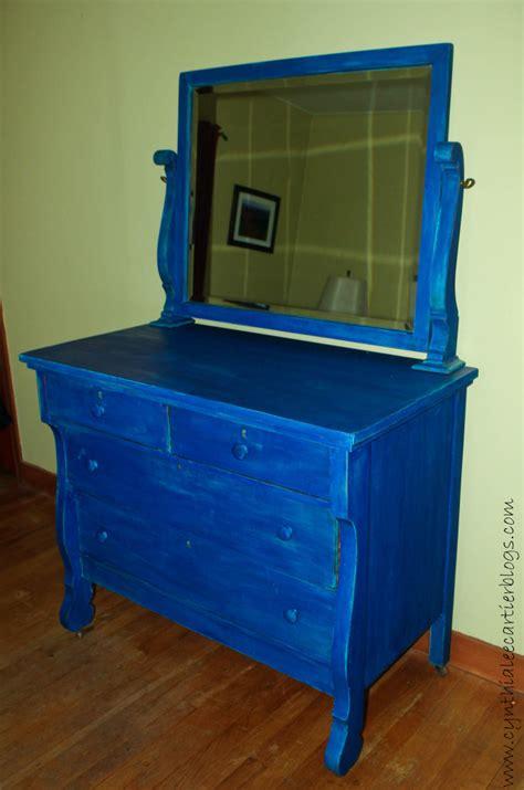 milk paint distressing an antique dresser blue