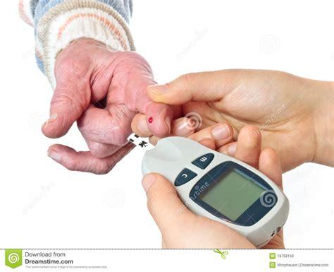 diabetes senior woman measuring glucose level blood test
