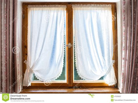 wooden window curtains old wooden window with white curtains stock photo image