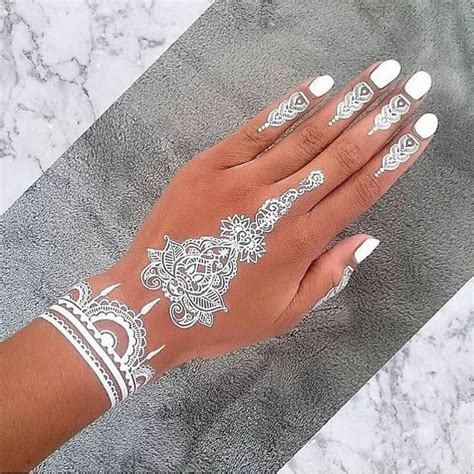 white henna tattoo on hand 49 beautiful henna tattoos for