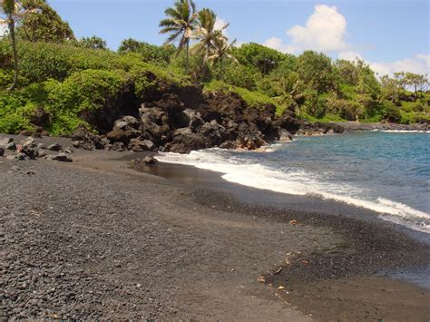 beach with black sand black sand beaches
