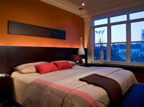 bedroom cove lighting masculine orange bedroom with dramatic lighting hgtv