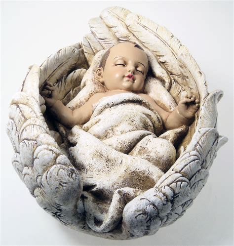large baby sleeping in angel wings statue gift ornament