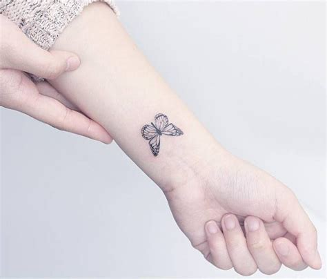 tattoo hand mini small butterfly tattoo on the left inner wrist tattoo