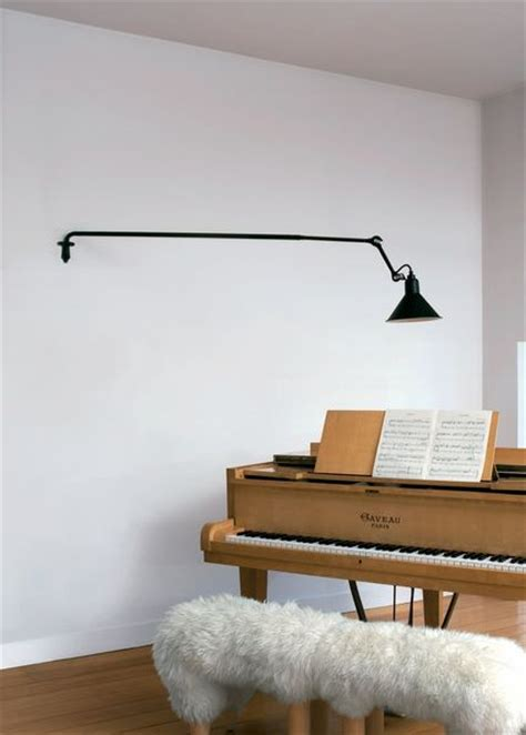 andrew neyer wall light wall l the piano furnish sheepskin