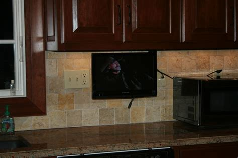cabinet tv mount kitchen anyone a swivel wall mount tv in the kitchen