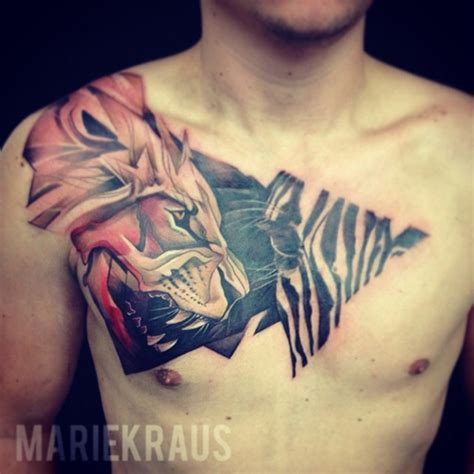 lion hunting zebra chest tattoo i fucking love tattoos