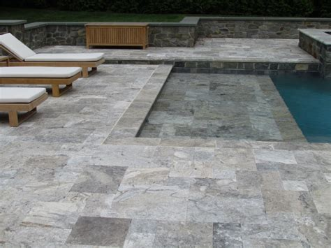 silvery grey travertine pool coping bullnose drop face