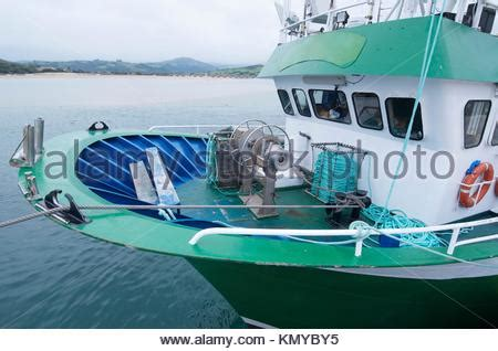 bow of a boat in spanish small commercial spanish fishing boat leaving santa pola