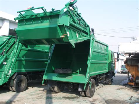garbage compactor compactor vehicles pressed into service to make city cleaner